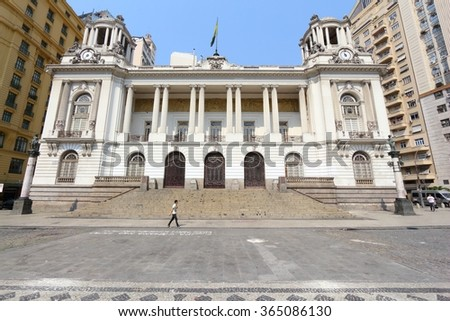 RIO DE JANEIRO, BRAZIL - OCTOBER 19, 2014: People walk by Municipal Chamber in downtown Rio de Janeiro. In 2013 1.6 million international tourists visited Rio. - stock photo
