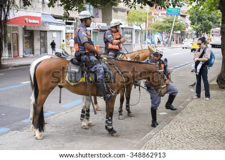 RIO DE JANEIRO, BRAZIL - OCTOBER 25, 2015: Police horses stand by on the street in Ipanema in October 2015 in part of an effort to increase police presence after an increase in assaults in the city.