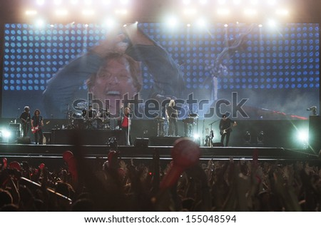 RIO DE JANEIRO, BRAZIL - SEPTEMBER 20: Fans sing along with Jon Bon Jovi, lead singer of the US rock band Bon Jovi, during their performance at the Rock in Rio 2013 concert, on September 20, 2013 in Rio de Janeiro, Brazil.