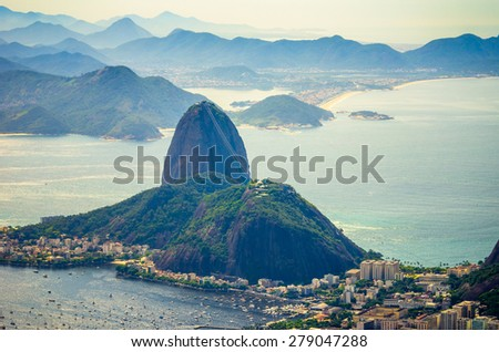 Rio de Janeiro, Brazil. Sugarloaf Mountain and other mountains in background - filtered view - stock photo