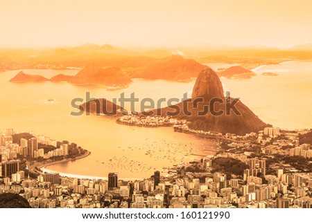 Rio de Janeiro, Brazil. Suggar Loaf and  Botafogo beach viewed from Corcovado at sunrise. - stock photo