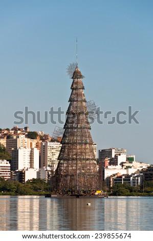 RIO DE JANEIRO - DECEMBER 18, 2014: Huge metal structure of a christmas tree in Rodrigo de Freitas lagoon. The tree is illuminated each night. - stock photo