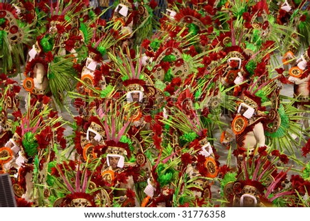 RIO DE JANEIRO - FEBRUARY 22: A group of Samba dancer dressed up for the Rio Carnival in Sambadome February 22, 2009 in Rio de Janeiro, Brazil. The Rio Carnival is the biggest carnival in the world. - stock photo