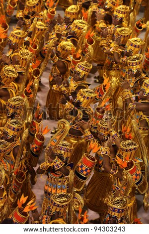 RIO DE JANEIRO - FEBRUARY 22: A group of Samba dancers dressed up for the Rio Carnival in Sambadome February 22, 2009 in Rio de Janeiro, Brazil. The Rio Carnival is the biggest carnival in the world - stock photo