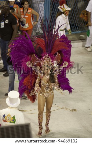 RIO DE JANEIRO - FEBRUARY 22: A Samba dancer dressed up for the Rio Carnival in Sambadome February 22, 2009 in Rio de Janeiro, Brazil. The Rio Carnival is the biggest carnival in the world - stock photo