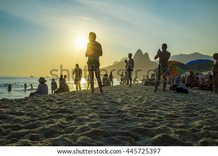 RIO DE JANEIRO - FEBRUARY 21, 2016: Beachgoers stop to take in the sunset on Ipanema Beach, which is often celebrated with a round of applause.