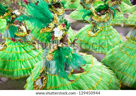 RIO DE JANEIRO - FEBRUARY 10:Dancers at carnival at Sambodromo in Rio de Janeiro February 10, 2013,  Brazil. The Rio Carnival is biggest carnival in world. - stock photo