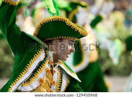 RIO DE JANEIRO - FEBRUARY 10: Performance of people at carnival in Rio de Janeiro at Sambodromo February 10, 2013,  Brazil. The Rio Carnival is biggest carnival in world. - stock photo