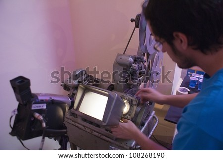 RIO DE JANEIRO - JULY 13: unidentified element of the staff prepares the projector to do a filming. Event Anima Mundi, July 13, 2012 in Rio de Janeiro, Brazil