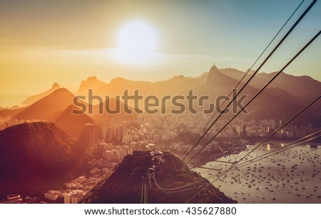 Rio De Janeiro late afternoon panorama with sun beam. Brazil. Vintage colors.