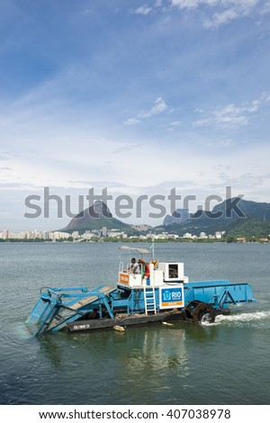 RIO DE JANEIRO - MARCH 3, 2016: Municipal aquatic weed harvesting equipment passes along Lagoa Rodrigo de Freitas lagoon, a venue for the Rio 2016 Olympic Games.