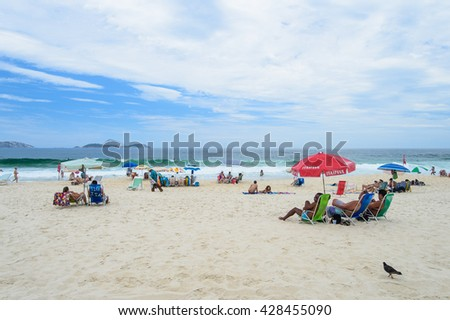 RIO DE JANEIRO - MARCH 3, 2014: People relax on Copacabana Beach is one of the most famous and crowded beaches in Rio de Janeiro, Brazil.