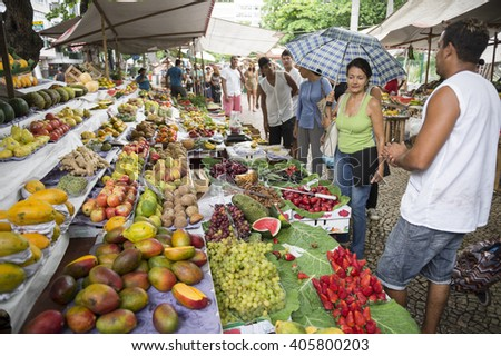 RIO DE JANEIRO - NOVEMBER 3, 2015: Shoppers browse the stalls of fruit at the local farmer's market in General Osorio Plaza in Ipanema.