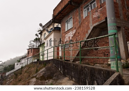 RIO DE JANEIRO  - OCTOBER 18, 2014: Fragile residential constructions of favela Vidigal in Rio de Janeiro. After installing Pacifying Police Units, favela became better and safer place to live in.