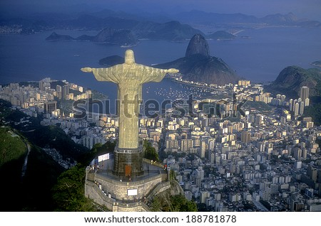 Rio de Janeiro, RJ, Brazil: Aerial view of Christ, symbol of Rio de Janeiro, standing on top of Corcovado Hill, overlooking Guanabara Bay - stock photo