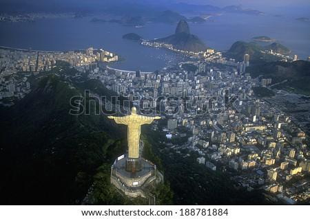 Rio de Janeiro, RJ, Brazil:  Aerial view of Christ, symbol of Rio de Janeiro, standing on top of Corcovado Hill, overlooking Guanabara Bay - stock photo