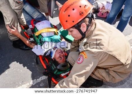 RIO DE JANEIRO, RJ - BRAZIL may, 10, 2015 - Simulation of car accident with several kinds of victims in the street of the city, to test the quality of medical care