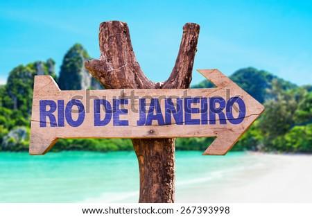 Rio de Janeiro wooden sign with beach background - stock photo