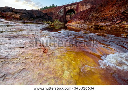 Rio Tinto - river with red water because it have a lot of iron oxide. Spain. - stock photo