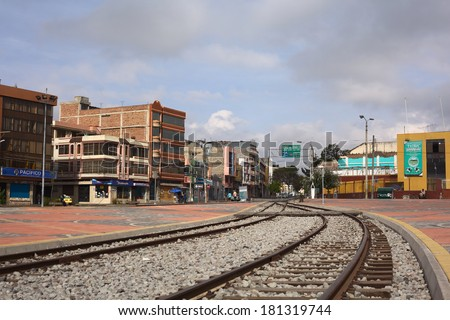 RIOBAMBA, ECUADOR - FEBRUARY 16, 2014: Rails leading out of the train station of Riobamba in the direction of the famous Nariz del Diablo (Devil's Nose) on February 16, 2014 in Riobamba, Ecuador - stock photo