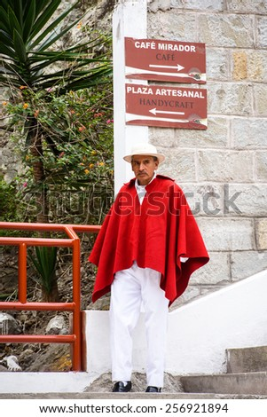 RIOBAMBA, ECUADOR - JAN 7, 2015: Unidentified Ecuadorian man in traditional red poncho. 71,9% of Ecuadorian people belong to the Mestizo ethnic group - stock photo