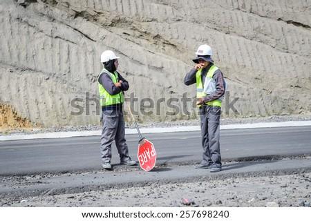 RIOBAMBA, ECUADOR - JAN 7, 2015: Unidentified Ecuadorian road workers. 71,9% of Ecuadorian people belong to the Mestizo ethnic group - stock photo