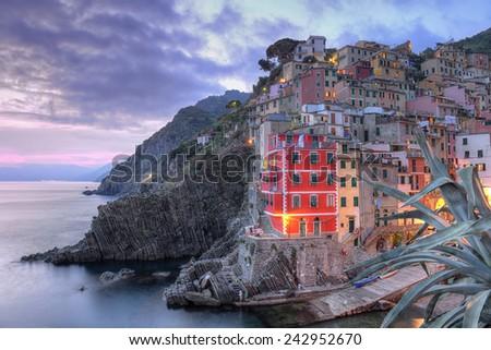 Riomaggiore, Cinque Terre, Italy surprised at sunset, at blue hour. - stock photo