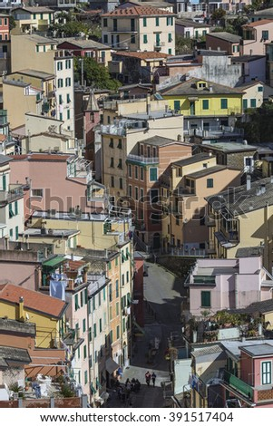 RIOMAGGIORE, ITALY - 05 MARCH, 2016 :People walking on the street of Riomaggiore village in Italy. Riomaggiore is one of five famous coastline villages in the Cinque Terre National Park, Liguria.