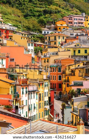 RIOMAGGIORE, ITALY - MAY 5, 2016: Houses of Riomaggiore, a village in province of La Spezia, Liguria, Italy. It's one of the lands of Cinque Terre, UNESCO World Heritage Site