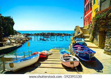 Riomaggiore village street, boats and sea in Five lands, Cinque Terre National Park, Liguria Italy Europe. - stock photo