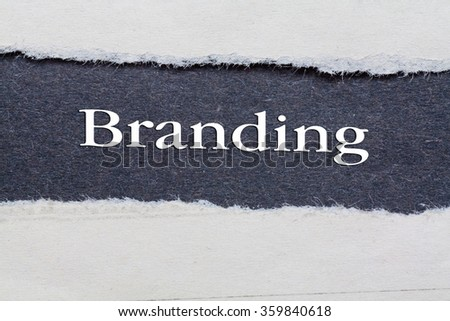 Rip Blue Paper and white background with branding written on - stock photo