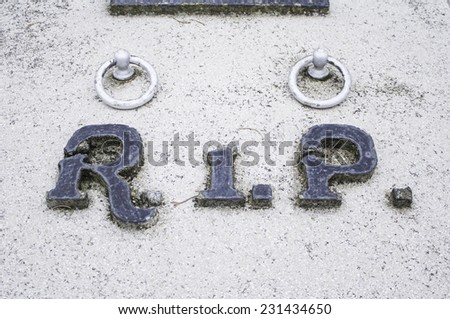 Rip in marble tomb cemetery, symbol - stock photo