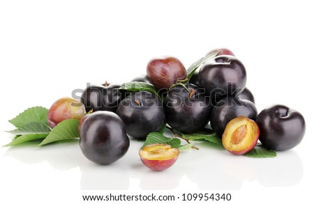Rip plums isolated on white - stock photo