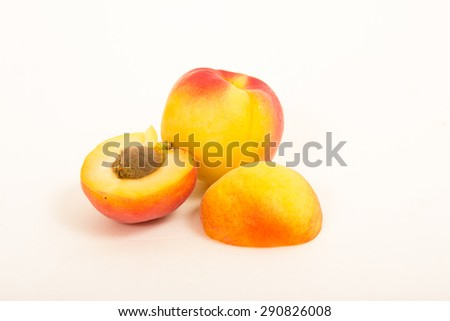 Ripe and fresh apricots on a white background
