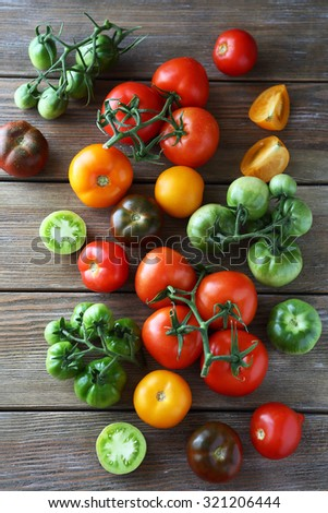 ripe and green tomatoes top view - stock photo