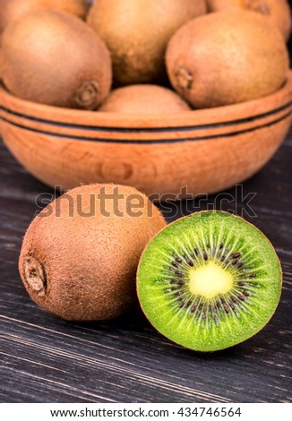 Ripe and juicy kiwi fruit on a background of a fruit bowl - stock photo