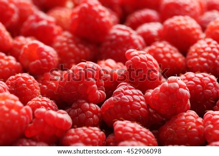 Ripe and sweet red raspberries background - stock photo