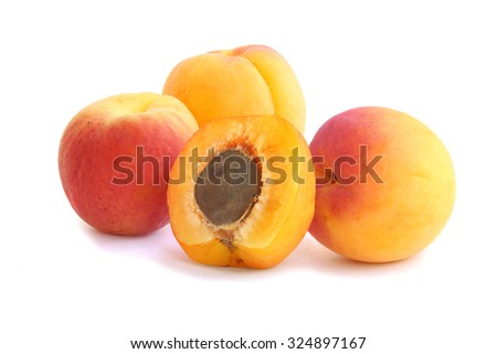 Ripe and tasty apricots with half isolated on white background