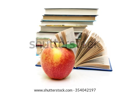 ripe apple and books on a white background. horizontal photo.