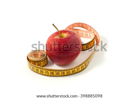 Ripe apple on a white background with measuring tape, diet and health.