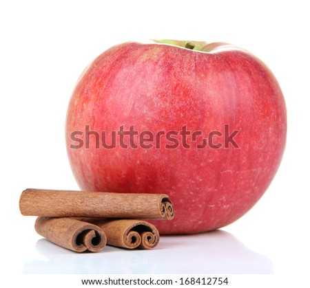 Ripe apple with with cinnamon sticks isolated on white