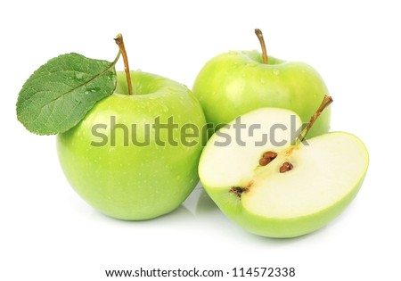 Ripe apples and cut apples on white - stock photo