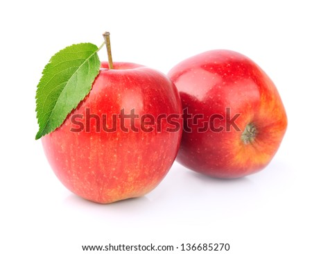 Ripe apples fruit with leaves close up on white - stock photo