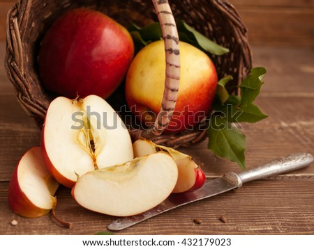 ripe apples in a basket on a wooden background