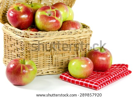 ripe apples in a wicker picnic basket isolated on white - stock photo