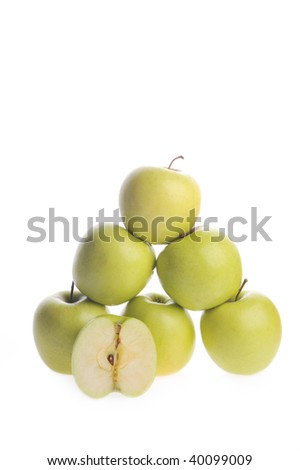 Ripe apples lie on  white surface