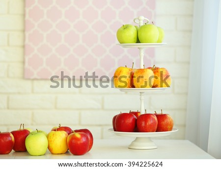 Ripe apples on a kitchen table - stock photo