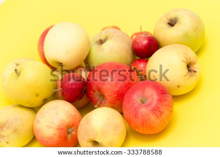 ripe apples on a yellow background