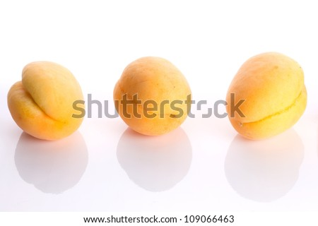 ripe apricot on white background