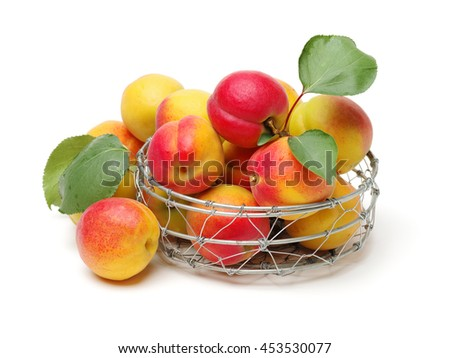 ripe apricot with leaves isolated on white background